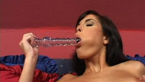 Nella plays with a big glass dildo