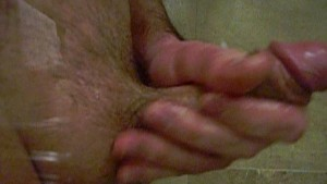 jacking off with cumshot on glass closeup