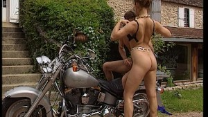 Motorcycle babe likes a guy with a long cigar
