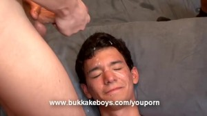 Twink takes a cum shower after sucking