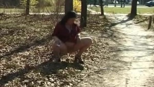 chubby girl peeing in nature