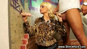 Slutty blond gets rammed from behind whille sucking the gloryhole cock