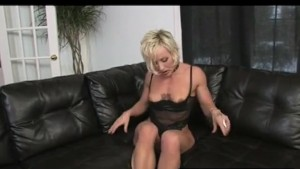 Tattooed Blonde Uses Dildo to Orgasm