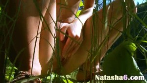 Natasha peeing in the forest