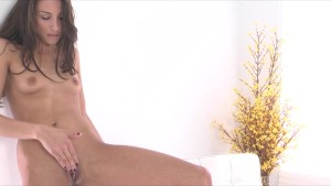 Beautiful skinny brunette Celeste Star fucks herself with dildo