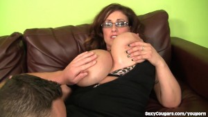 Busty MILF Goes After Younger Man