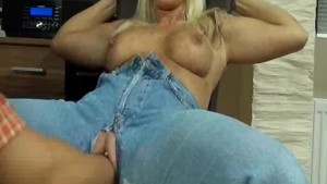 Doggy style fisting through her denim crotch