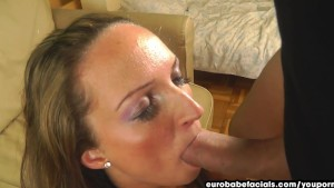 Smiling her way through a blowjob session