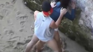 Voyeur video of a couple having intense sex at the beach
