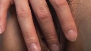 Sweet brunette Asian babe rubs her wet pussy