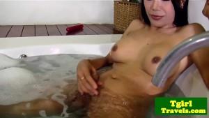 Asian shemale Melissa wanks in bathtub