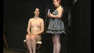 Submissive Lyarah facial candle waxing and lesbian domination of amateur slavegirl from Canada in kinky girl on girl BDSM and humiliation