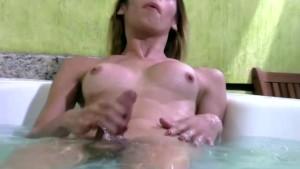 Cute t-girl is dancing in string bikini and wanking wet cock