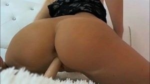 Tanned blonde double penetrates her both holes