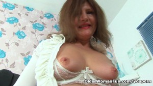 German milf Kristine rips a hole in her pantyhose