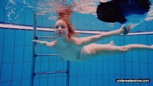 Teen girl Avenna is swimming i