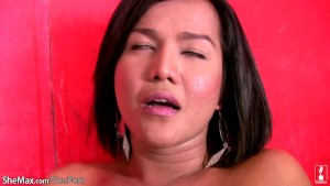 Filipino ladyboy with pretty face fondles tits and strokes