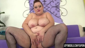 Huge boobed girl and red sex toy