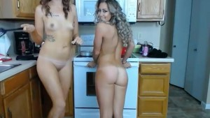 Mom and daughter fooling around in the kitchen...
