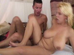Picture Blonde with huge tits likes to give handjob...