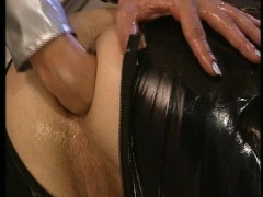 Picture Latex man fucked and fisted by latex woman