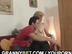 Picture Blonde granny jumps on his young cock