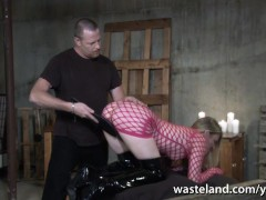 Picture Blonde sex slave in fishnet dress gets spank...