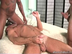 Picture Muscular white guy gets banged by two black...