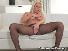 Picture Blonde milf Kathy peels off her black nylons...