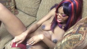 Black chick plays on couch