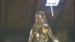 Golden painted Renata showing pussy