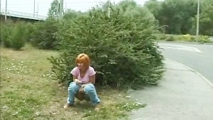 young redhead peeing in public