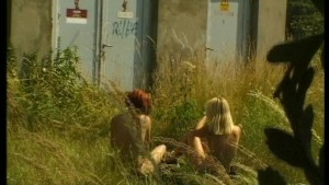 Two girls play around in the bush