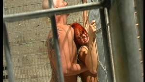 Fucking her up against the cage