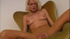 Russian MILF strips and plays with big dildo
