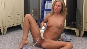 Sexy blonde plays in the changing room