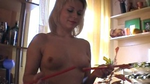 Blonde girl gets kinky with candles and a bottle