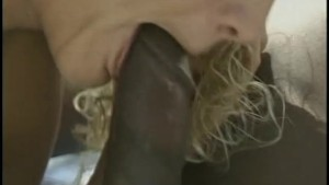 Curly-haired blonde enjoys two black cocks