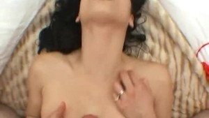 Sexy brunette takes a load on her face