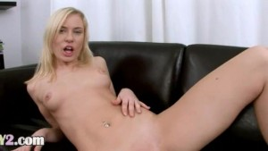 blond babe fingering on leather sofa