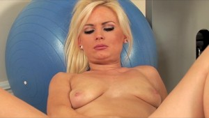 Cute blonde Alexis Jade rubs her shaved pussy in the gym