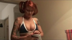 Tattooed redhead doing her makeup - Sologirlcontent