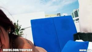 Sun bathing beauty slides her bikini bottoms to the side