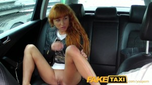 FakeTaxi Long red hair and a nice shaved pussy