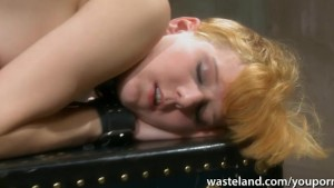 Ginger sex slave had her shaved pussy treated like a toy