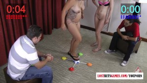 Two girls play a strip memory game as two guys watch