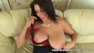 British milf Lulu works her big naturals and wet pussy