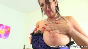 British milf Lulu fondles her big tits and fucks herself
