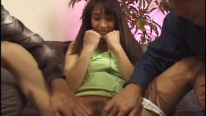 Asian woman in pantyhose gets her pussy teased with sex toys by two guys