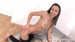 Adorable young lady drilling her smooth twat
